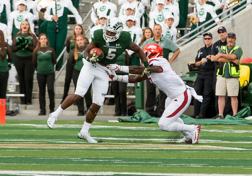 . Colorado State running back Marvin Kinsey Jr., (5) tries to escape from Arkansas linebacker De�Jon Harris (8) after catching a pass outside Saturday evening Sept., 8, 2018 at Canvas Stadium in Fort Collins. (Michael Brian/For the Reporter-Herald)