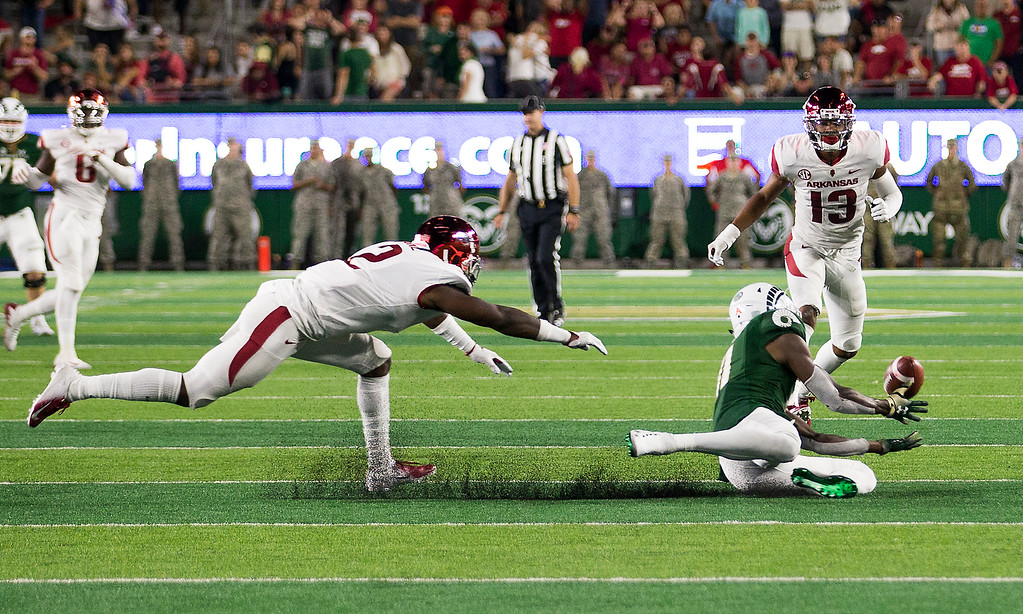 . Colorado State wide receiver Preston Williams (11) slides for a catch on the winning drive against Arkansas Saturday evening Sept., 8, 2018 at Canvas Stadium in Fort Collins. The Rams beat the visiting Razorbacks, 34-27. (Michael Brian/For the Reporter-Herald)
