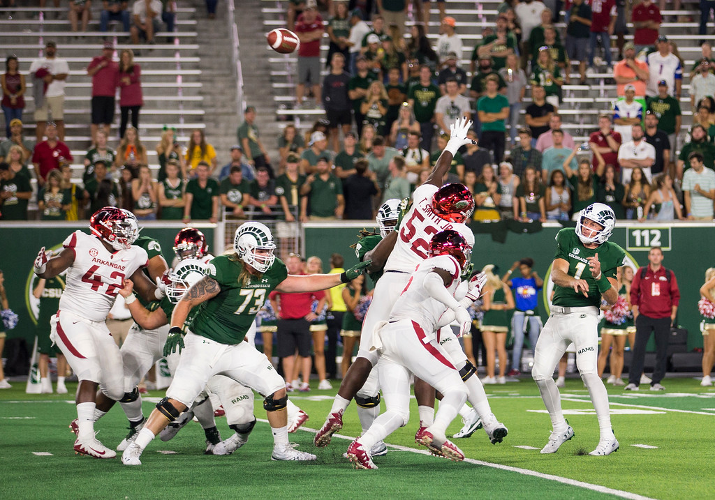 . Colorado State quarterback K.J. Carta-Samuels (1) gets the ball away while under pressure from the Arkansas defense Saturday evening Sept., 8, 2018 at Canvas Stadium in Fort Collins. The Rams came from behind to win, 34-27. (Michael Brian/For the Reporter-Herald)