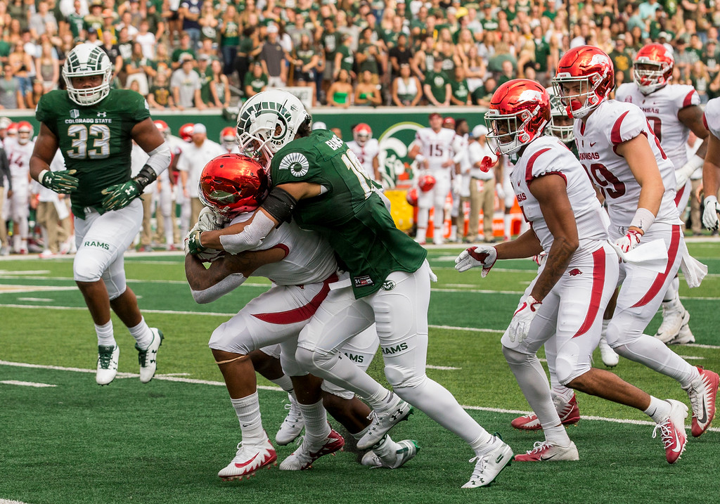 . Colorado State cornerback V.J. Banks (19) tackles Arkansas wide receiver Jonathan Nance (7) before he can get to the end zone Saturday evening Sept., 8, 2018 at Canvas Stadium in Fort Collins. (Michael Brian/For the Reporter-Herald)