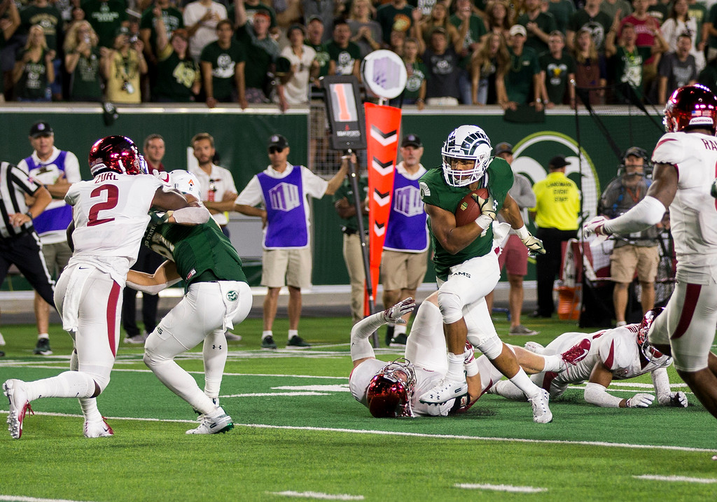. Colorado State running back Izzy Matthews (24) runs through tackles toward the end zone on the Ram\'s winning drive Saturday evening Sept., 8, 2018 at Canvas Stadium in Fort Collins. Colorado State came from behind to beat Arkansas 34-27. (Michael Brian/For the Reporter-Herald)