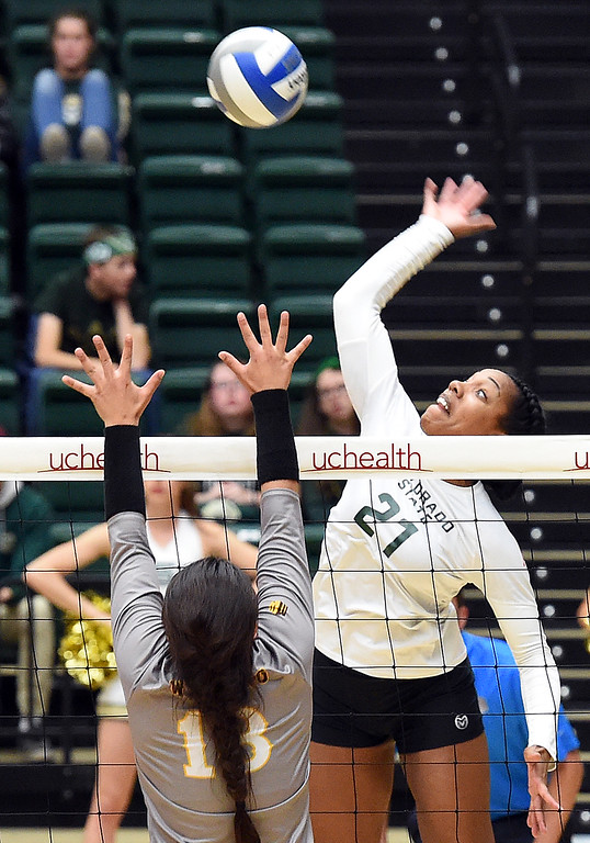 . Colorado State\'s Jessica Jackson spikes the ball as Wyoming\'s Cori Aafedt tries to block during their game on Tuesday, Oct. 30, 2018, at Moby Arena in Fort Collins.  (Photo by Jenny Sparks/Loveland Reporter-Herald)