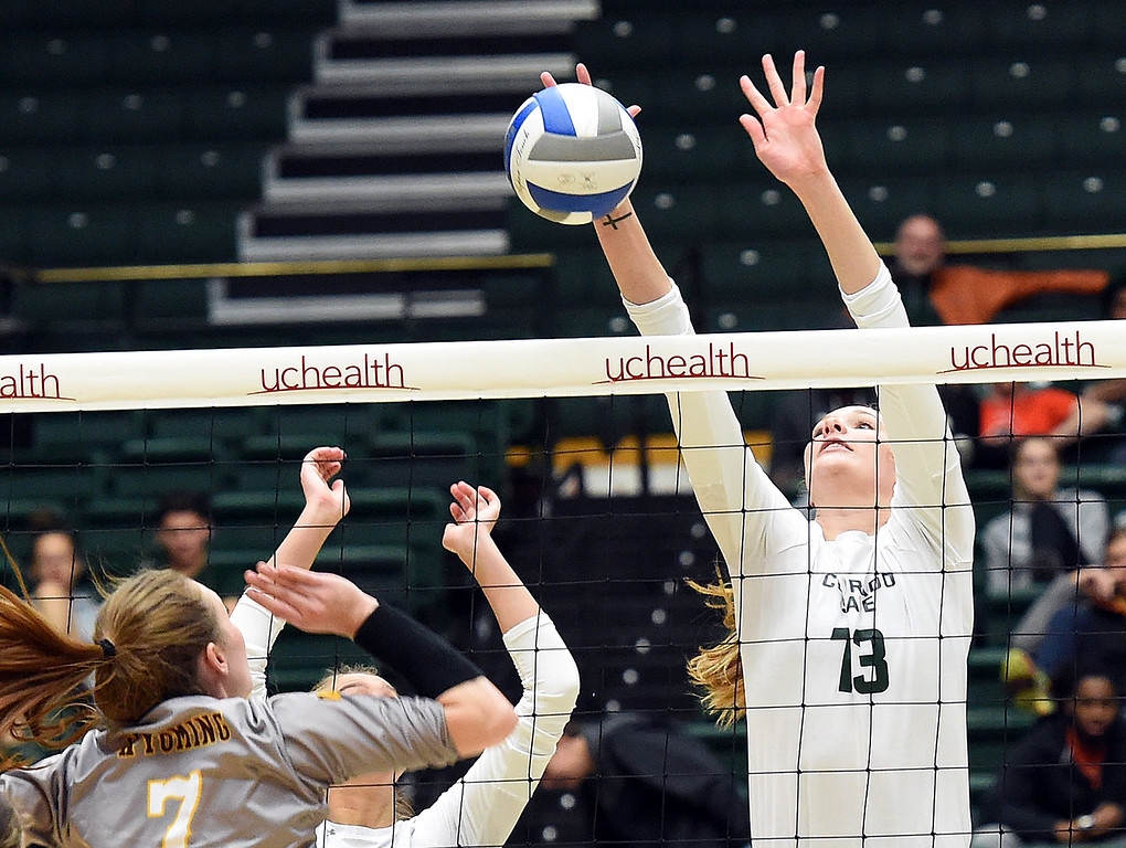 . Colorado State\'s Kirstie Hillyer blocks the ball as Wyoming\'sTara Traphagan tries to block during their game on Tuesday, Oct. 30, 2018, at Moby Arena in Fort Collins.  (Photo by Jenny Sparks/Loveland Reporter-Herald)