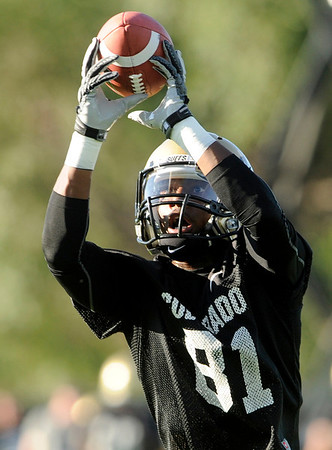 "University of Colorado's Austin Vincent makes a catch on Friday, Aug. 5, during the Buff's second football practice on the University of Colorado practice field in Boulder. For more photos and interviews from the practice go to  <a href=""http://www.dailycamera.com"">http://www.dailycamera.com</a><br /> Jeremy Papasso/ Camera"