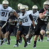 "University of Colorado's Nelson Spruce runs past defenders  on Friday, Aug. 5, during the Buff's second football practice on the University of Colorado practice field in Boulder. For more photos and interviews from the practice go to  <a href=""http://www.dailycamera.com"">http://www.dailycamera.com</a><br /> Jeremy Papasso/ Camera"