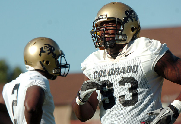 "University of Colorado defensive lineman Conrad Obi, right, catches his breathe after a drill on Friday, Aug. 5, during the Buff's second football practice on the University of Colorado practice field in Boulder. For more photos and interviews from the practice go to  <a href=""http://www.dailycamera.com"">http://www.dailycamera.com</a><br /> Jeremy Papasso/ Camera"