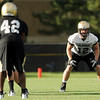 "University of Colorado's Patrick Mahnke, right, on Friday, Aug. 5, during the Buff's second football practice on the University of Colorado practice field in Boulder. For more photos and interviews from the practice go to  <a href=""http://www.dailycamera.com"">http://www.dailycamera.com</a><br /> Jeremy Papasso/ Camera"