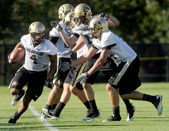 """University of Colorado defensive back Kyle Washington runs with the ball  on Friday, Aug. 5, during the Buff's second football practice on the University of Colorado practice field in Boulder. For more photos and interviews from the practice go to  <a href=""""http://www.dailycamera.com"""">http://www.dailycamera.com</a><br /> Jeremy Papasso/ Camera"""