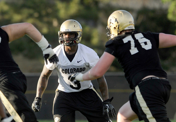 """University of Colorado's Douglas Rippy works on his defensive skills  on Friday, Aug. 5, during the Buff's second football practice on the University of Colorado practice field in Boulder. For more photos and interviews from the practice go to  <a href=""""http://www.dailycamera.com"""">http://www.dailycamera.com</a><br /> Jeremy Papasso/ Camera"""