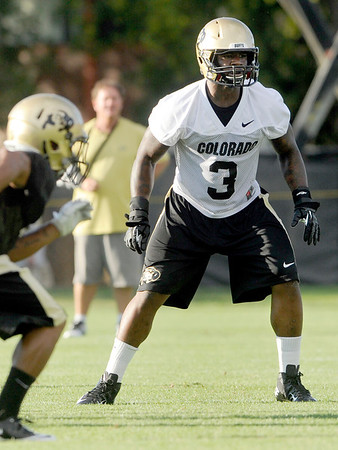 "University of Colorado inside linebacker Douglas Rippy watches the play carefully on Friday, Aug. 5, during the Buff's second football practice on the University of Colorado practice field in Boulder. For more photos and interviews from the practice go to  <a href=""http://www.dailycamera.com"">http://www.dailycamera.com</a><br /> Jeremy Papasso/ Camera"
