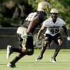 "University of Colorado's Lowell Williams, right, reads the play on Friday, Aug. 5, during the Buff's second football practice on the University of Colorado practice field in Boulder. For more photos and interviews from the practice go to  <a href=""http://www.dailycamera.com"">http://www.dailycamera.com</a><br /> Jeremy Papasso/ Camera"
