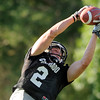 "University of Colorado's Logan Gray makes a leaping catch on Friday, Aug. 5, during the Buff's second football practice on the University of Colorado practice field in Boulder. For more photos and interviews from the practice go to  <a href=""http://www.dailycamera.com"">http://www.dailycamera.com</a><br /> Jeremy Papasso/ Camera"