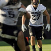 """University of Colorado's Vince Ewing, right, reads the play on Friday, Aug. 5, during the Buff's second football practice on the University of Colorado practice field in Boulder. For more photos and interviews from the practice go to  <a href=""""http://www.dailycamera.com"""">http://www.dailycamera.com</a><br /> Jeremy Papasso/ Camera"""