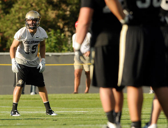 "University of Colorado's Travis Sandersfeld on Friday, Aug. 5, during the Buff's second football practice on the University of Colorado practice field in Boulder. For more photos and interviews from the practice go to  <a href=""http://www.dailycamera.com"">http://www.dailycamera.com</a><br /> Jeremy Papasso/ Camera"