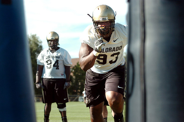 "University of Colorado defensive lineman Conrad Obi works on his moves on Friday, Aug. 5, during the Buff's second football practice on the University of Colorado practice field in Boulder. For more photos and interviews from the practice go to  <a href=""http://www.dailycamera.com"">http://www.dailycamera.com</a><br /> Jeremy Papasso/ Camera"