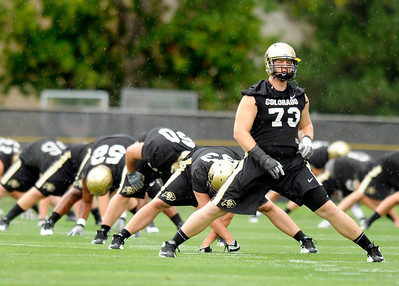 University of Colorado offensive lineman Ryan Miller, No. 73, stretches with the rest of his team on Thursday, Aug. 4, during the Buff's first football practice on the University of Colorado practice field in Boulder. For more photos and interviews from the practice go to www.dailycamera.com Jeremy Papasso/ Camera