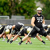 "University of Colorado offensive lineman Ryan Miller, No. 73, stretches with the rest of his team on Thursday, Aug. 4, during the Buff's first football practice on the University of Colorado practice field in Boulder. For more photos and interviews from the practice go to  <a href=""http://www.dailycamera.com"">http://www.dailycamera.com</a><br /> Jeremy Papasso/ Camera"