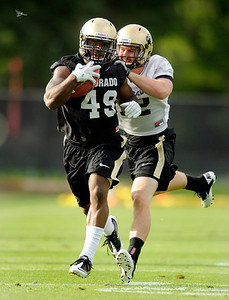 University of Colorado fullback Even Harrington runs the ball on Thursday, Aug. 4, during the Buff's first football practice on the University of Colorado practice field in Boulder. For more photos and interviews from the practice go to www.dailycamera.com Jeremy Papasso/ Camera