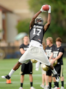 University of Colorado wide receiver Toney Clemons makes a leaping catch on Thursday, Aug. 4, during the Buff's first football practice on the University of Colorado practice field in Boulder. For more photos and interviews from the practice go to www.dailycamera.com Jeremy Papasso/ Camera