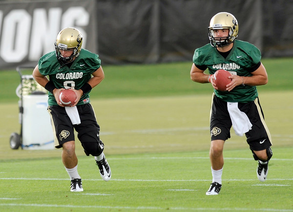 "University of Colorado quarterback Tyler Hansen, left, and quarterback Brent Burnette work on some drills on Thursday, Aug. 4, during the Buff's first football practice on the University of Colorado practice field in Boulder. For more photos and interviews from the practice go to  <a href=""http://www.dailycamera.com"">http://www.dailycamera.com</a><br /> Jeremy Papasso/ Camera"