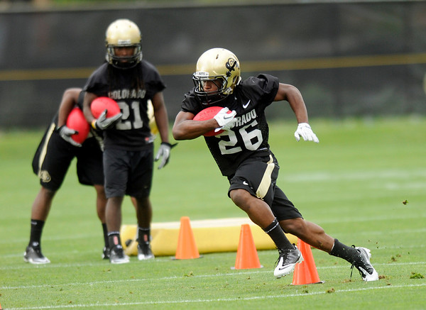 "University of Colorado tailback Tony Jones runs some drills on Thursday, Aug. 4, during the Buff's first football practice on the University of Colorado practice field in Boulder. For more photos and interviews from the practice go to  <a href=""http://www.dailycamera.com"">http://www.dailycamera.com</a><br /> Jeremy Papasso/ Camera"