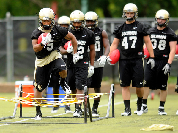 "University of Colorado tailback Rodney Stewart runs some drills on Thursday, Aug. 4, during the Buff's first football practice on the University of Colorado practice field in Boulder. For more photos and interviews from the practice go to  <a href=""http://www.dailycamera.com"">http://www.dailycamera.com</a><br /> Jeremy Papasso/ Camera"