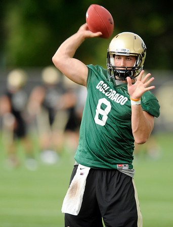 "University of Colorado quarterback Nick Hirschman throws a pass on Thursday, Aug. 4, during the Buff's first football practice on the University of Colorado practice field in Boulder. For more photos and interviews from the practice go to  <a href=""http://www.dailycamera.com"">http://www.dailycamera.com</a><br /> Jeremy Papasso/ Camera"
