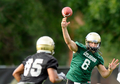 University of Colorado quarterback Nick Hirschman throws a pass to tight end DaVaughn Thornton on Thursday, Aug. 4, during the Buff's first football practice on the University of Colorado practice field in Boulder. For more photos and interviews from the practice go to www.dailycamera.com Jeremy Papasso/ Camera