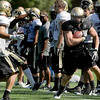 University of Colorado's Ryan Deehan runs with the ball on Saturday, Aug. 6, at the CU Buff's third practice of the season.<br /> Jeremy Papasso/ Camera