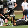 University of Colorado's Ray Polk, left, and Anthony Perkins both hit the ground after missing an interception opportunity on Saturday, Aug. 6, at the CU Buff's third practice of the season.<br /> Jeremy Papasso/ Camera