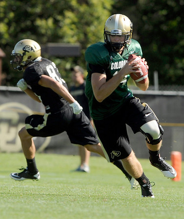 University of Colorado quarterback John Schrock looks for an open receiver on Saturday, Aug. 6, at the CU Buff's third practice of the season.<br /> Jeremy Papasso/ Camera