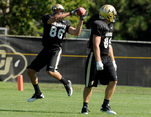 University of Colorado's Alex Turbow makes a leaping catch on Saturday, Aug. 6, at the CU Buff's third practice of the season.<br /> Jeremy Papasso/ Camera