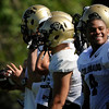 University of Colorado's Keenan Canty, No. 4, smiles as he chats with another player on the sideline on Saturday, Aug. 6, at the CU Buff's third practice of the season.<br /> Jeremy Papasso/ Camera