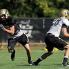 University of Colorado's Kyle Cefalo, left, runs a receiving route on Saturday, Aug. 6, at the CU Buff's third practice of the season.<br /> Jeremy Papasso/ Camera