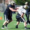 Jon Major (31) fights against Nick Kasa (84) during the University of Colorado football team practice on Tuesday March 20, 2012.<br /> For more photos of the game go to www.buffzone. com<br /> Photo by Paul Aiken / The Camera