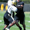Lowell Williams (45) gets blocked by Kyle Slavin (88) during the University of Colorado football team practice on Tuesday March 20, 2012.<br /> For more photos of the game go to www.buffzone. com<br /> Photo by Paul Aiken / The Camera
