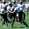 Lowell Williams (45) gets sandwiched by Woodson Greer (37) and Kyle Washington (4) during the University of Colorado football team practice on Tuesday March 20, 2012.<br /> For more photos of the game go to www.buffzone. com<br /> Photo by Paul Aiken / The Camera