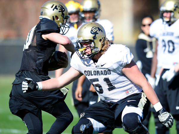 John Tuso (51) gets beaten by a runner during the University of Colorado football team practice on Tuesday March 20, 2012.<br /> For more photos of the game go to www.buffzone. com<br /> Photo by Paul Aiken / The Camera
