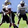 Greg Henderson (20) and Terrel Smith (41) bang pads during the University of Colorado football team practice on Tuesday March 20, 2012.<br /> For more photos of the game go to www.buffzone. com<br /> Photo by Paul Aiken / The Camera