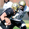 Kirk Poston (91) pursues a runner during the University of Colorado football team practice on Tuesday March 20, 2012.<br /> For more photos of the game go to www.buffzone. com<br /> Photo by Paul Aiken / The Camera