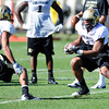 Kyle Washington (4) tries to evade K.T. Tu'umalo (42) during the University of Colorado football team practice on Tuesday March 20, 2012.<br /> For more photos of the game go to www.buffzone. com<br /> Photo by Paul Aiken / The Camera