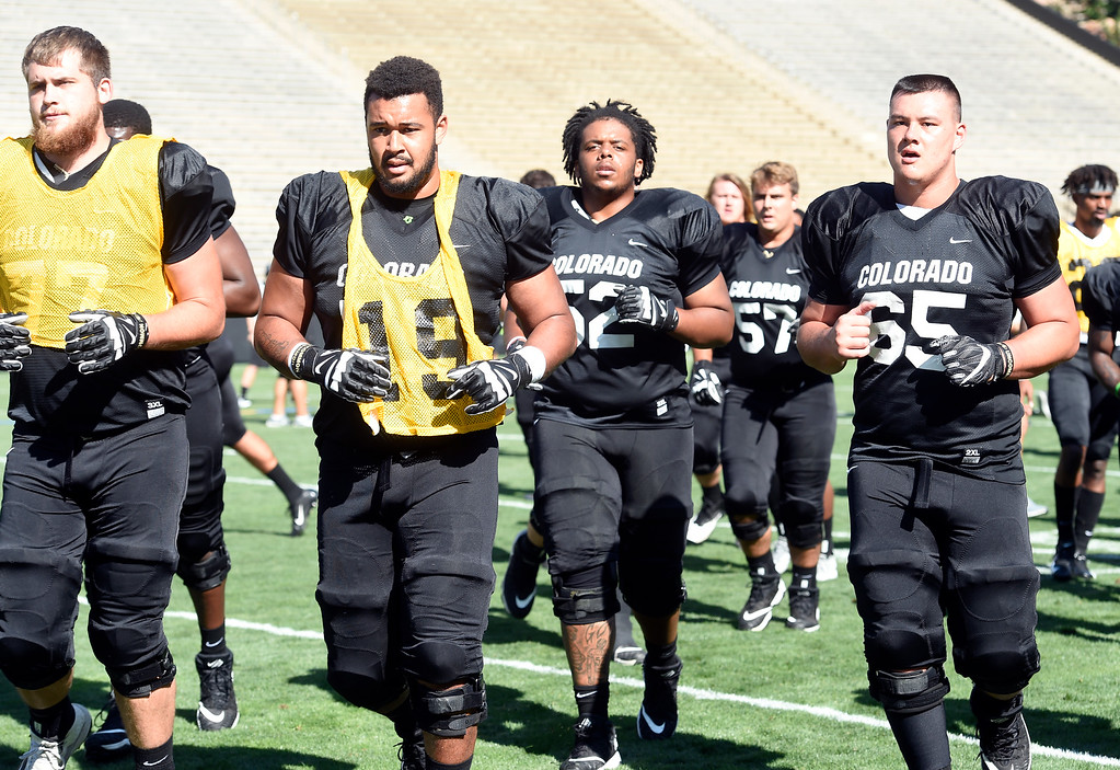 . Boulder, CO - AUGUST 11: Hunter Vaughn, left, Josh Kaiser, Joshua Jynes, and Colby Pursell, during the University of Colorado football scrimmage on August 11, 2018.(Photo by Cliff Grassmick/Staff Photographer)