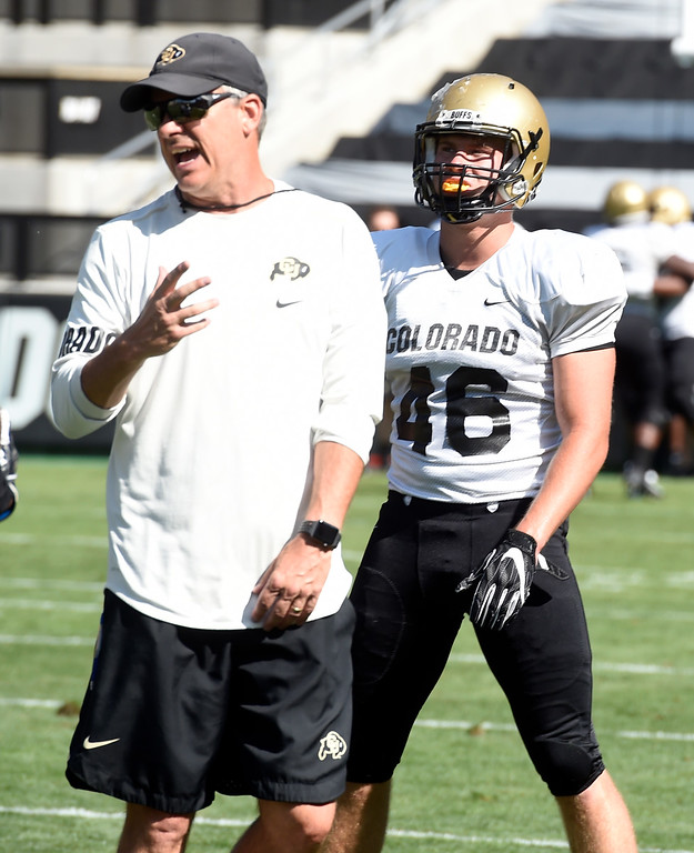 . Boulder, CO - AUGUST 11: Ross Els, left, and Chase Newman, during the University of Colorado football scrimmage on August 11, 2018.(Photo by Cliff Grassmick/Staff Photographer)
