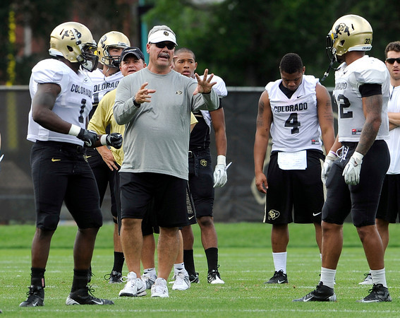 "University of Colorado run game coordinator and linebacker coach Brian Cabral gives instructions to the players on Friday, Aug. 10, during the CU Football Fall Camp at the practice fields in Boulder. For more photos of the practice go to  <a href=""http://www.dailycamera.com"">http://www.dailycamera.com</a><br /> Jeremy Papasso/ Camera"