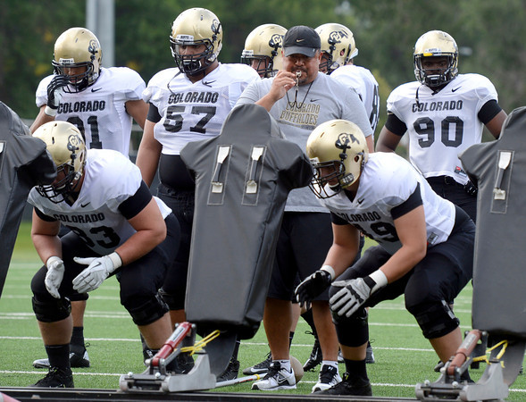 "University of Colorado defensive line coach Mike Tuiasosopo blows the whistle during a drill on Friday, Aug. 10, during the CU Football Fall Camp at the practice fields in Boulder. For more photos of the practice go to  <a href=""http://www.dailycamera.com"">http://www.dailycamera.com</a><br /> Jeremy Papasso/ Camera"