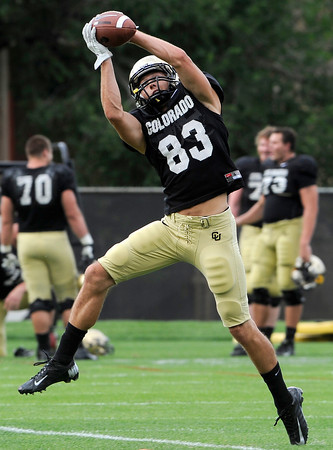 "University of Colorado's Dustin Ebner makes a jumping catch on Friday, Aug. 10, during the CU Football Fall Camp at the practice fields in Boulder. For more photos of the practice go to  <a href=""http://www.dailycamera.com"">http://www.dailycamera.com</a><br /> Jeremy Papasso/ Camera"