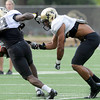"University of Colorado's Harrison Hunter, left, tries to avoid a tackle by Ray Polk on Friday, Aug. 10, during the CU Football Fall Camp at the practice fields in Boulder. For more photos of the practice go to  <a href=""http://www.dailycamera.com"">http://www.dailycamera.com</a><br /> Jeremy Papasso/ Camera"