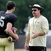 "University of Colorado special teams coordinator J.D. Brookhart talks with punter Zach Grossnickle on Friday, Aug. 10, during the CU Football Fall Camp at the practice fields in Boulder. For more photos of the practice go to  <a href=""http://www.dailycamera.com"">http://www.dailycamera.com</a><br /> Jeremy Papasso/ Camera"