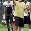 "University of Colorado defensive coordinator Greg Brown gives instructions to the players on Friday, Aug. 10, during the CU Football Fall Camp at the practice fields in Boulder. For more photos of the practice go to  <a href=""http://www.dailycamera.com"">http://www.dailycamera.com</a><br /> Jeremy Papasso/ Camera"