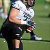 CUFOOT<br /> Offensive lineman Matthew Bahr does drills at CU practice on Tuesday.<br /> Photo by Marty Caivano/Camera/Aug. 10, 2010